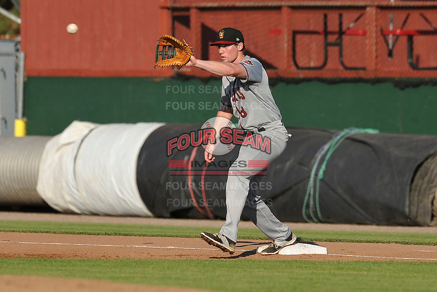 Quad Cities River Bandits Connor Goedert (8) waits for throw at first base during the Midwest League game against the Burlington Bees at Community Field on June 10, 2016 in Burlington, Iowa.  The Bees won 3-1.  (Dennis Hubbard/Four Seam Images)
