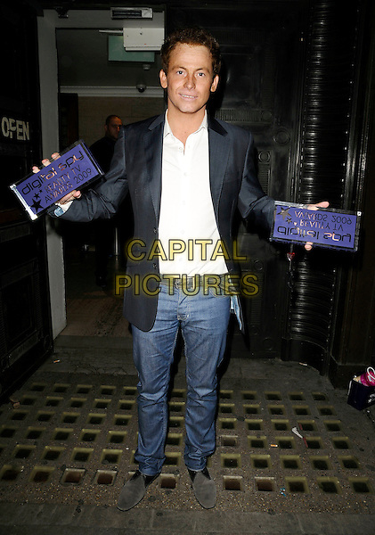 JOE SWASH.Digital Spy Reality TV Awards at the Bloomsbury Ballroom, London, England.  .April 6th, 2009.full length white shirt award trophy trophies jeans denim black jacket.CAP/CAN.©Can Nguyen/Capital Pictures.