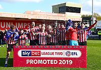 Lincoln City players celebrate promotion at the end of the game<br /> <br /> Photographer Andrew Vaughan/CameraSport<br /> <br /> The EFL Sky Bet League Two - Lincoln City v Cheltenham Town - Saturday 13th April 2019 - Sincil Bank - Lincoln<br /> <br /> World Copyright © 2019 CameraSport. All rights reserved. 43 Linden Ave. Countesthorpe. Leicester. England. LE8 5PG - Tel: +44 (0) 116 277 4147 - admin@camerasport.com - www.camerasport.com