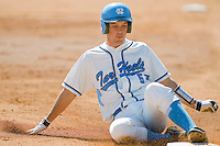 Jacob Stallings #5 of the North Carolina Tar Heels slides into third base with a triple against the Florida State Seminoles at Boshamer Stadium March 20, 2010, in Chapel Hill, North Carolina.  Photo by Brian Westerholt / Four Seam Images