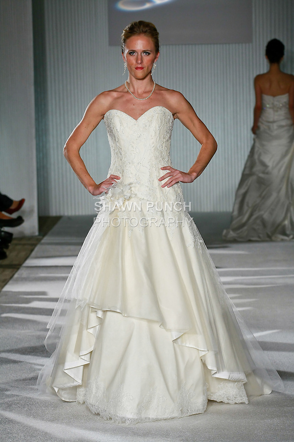Model walks the runway in a Wedding dress by CB Couture, for the CB Couture Spring 2011 fashion show during the Wedding Trendspot Press Fashion Show, October 17, 2010.