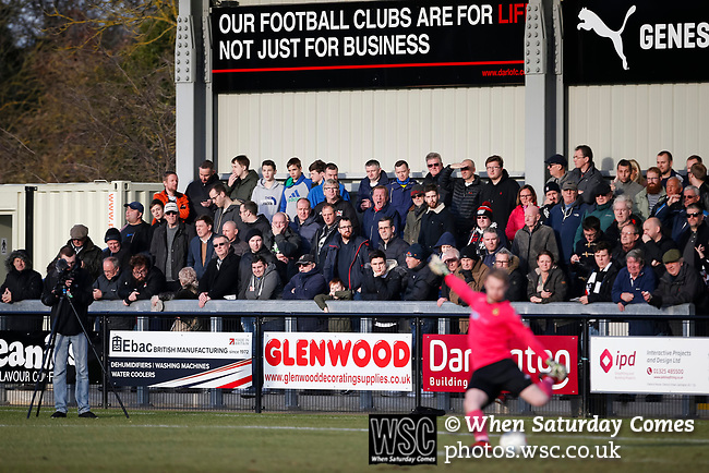 Darlington fans watching from the Tin Shed End. Darlington 1883 v Southport, National League North, 16th February 2019. The reborn Darlington 1883 share a ground with the town's Rugby Union club. <br /> After several years of relegations, bankruptcies, and ground moves, the club is fan owned, and back on an even keel in the National League North.<br /> A 0-0 draw with Southport was marred by a broken leg and dislocated knee suffered by Sam Muggleton, Darlington's on loan left back.<br /> Both teams finished the season in lower mid table.