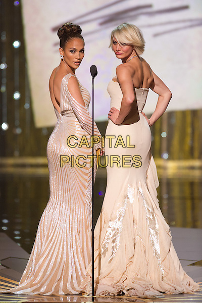 Jennifer Lopez and Cameron Diaz present at the 84th Annual Academy Awards® from Hollywood, CA February 26, 2012..*Editorial Use Only*.oscars full length stage dress white silver strapless hands on hips posing looking over shoulder back behind rear.CAP/A.M.P.A.S./NFS.©A.M.P.A.S. Supplied by Capital Pictures.