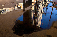 Cranes and the Bank of America tower are reflected in a puddle on a construction site. High rise construction projects are reshaping the Charlotte, NC, downtown business district. Photos taken as part of a story package on crane construction.