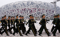 08 AUG 2008 - BEIJING, CHN - Soldiers parade outside the National Stadium before the Opening Ceremony -  Beijing Olympics. (PHOTO (C) NIGEL FARROW) *** IOC RULES APPLY ON USAGE ***