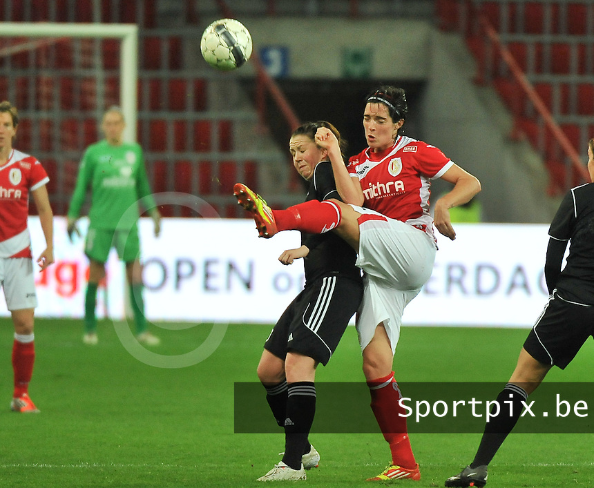 20131009 - LIEGE , BELGIUM : duel pictured between Standard's Cecile De Gernier (right) and Glasgow Suzanne Lappin (left) during the female soccer match between STANDARD Femina de Liege and  GLASGOW City LFC , in the 1/16 final ( round of 32 ) first leg in the UEFA Women's Champions League 2013 in stade maurice dufrasne - Sclessin in Liege. Wednesday 9 October 2013. PHOTO DAVID CATRY