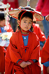 A young girl parades into the Hiromine Shrine during the Otaue Matsuri, or Rice Planting Festival