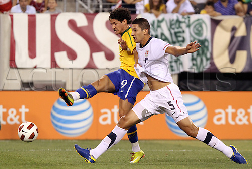 10 AUG 2010: Alexandre Pato (BRA) (9) and Omar Gonzalez (USA) (5). The United States Men's National Team lost to the Brazil Men's National Team 0-2 at New Meadowlands Stadium in East Rutherford, New Jersey in an international friendly soccer match.