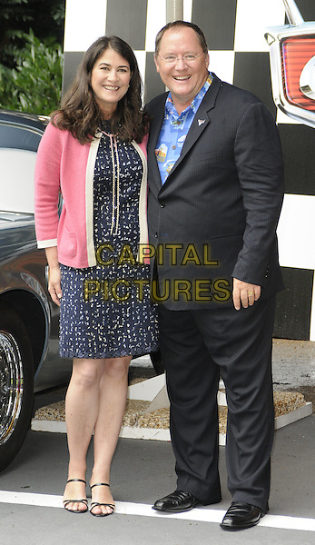 DENISE REAM (producer) & JOHN  LASSETER (director).UK Premiere of 'Cars 2' at Whitehall Gardens,  London, England..July 17th 2011.full length blue pink black print dress jacket suit shirt.CAP/CAN.©Can Nguyen/Capital Pictures.