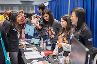 Workers from Goldman Sachs interact with visitors at a Career Expo held at the FIRST Robotics NYC Championship at the Jacob Javits Convention Center in New York on Sunday, March 13, 2016. The expo enables participants to speak with companies and professional organizations giving a real-world look into science and technology as used in the business world and their career opportunities. (© Richard B. Levine)