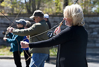 "NWA Democrat-Gazette/CHARLIE KAIJO Cathy Goulet of Rogers practices her cast during a fly fishing class, Sunday, April 14, 2019 at Hobbs State Park in Rogers.<br /> <br /> Instructor Sallyann Brown, past recipient of the ""Woman of the Year"" and the ""Federation of Fly Fishers Educator of the Year"" awards from the Federation of Fly Fishers, Inc. taught a four hour fly fishing class.<br /> <br /> Participants learned four basic casts, the six basic types of flies (lures), how to cast and ""play"" the flies in the water, how to read water, how to wade, how to purchase and assemble equipment, how to store equipment and how to tie the four basic knots used by fly fishers."