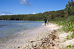 Divers walk along the beach after completing a dive off the lagoon at LauLau Bay in Saipan.  .Robert Gilhooly Photo