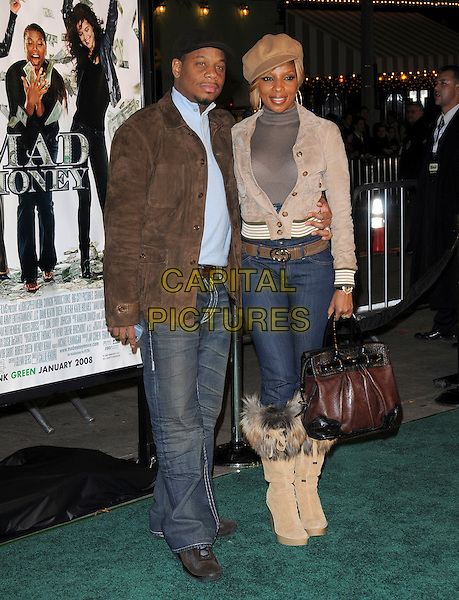 "KENDU ISAACS & MARY J. BLIGE.Overature Pictures' L.A. Premiere of ""Mad Money"" held at The Mann Village Theatre in Westwood, California, USA..January 9th, 2008.full length jeans denim tucked into fur lined trim boots beige hat jacket bag purse brown gold married husband wife.CAP/DVS.©Debbie VanStory/Capital Pictures"