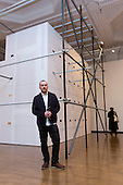 """Pictured: RA student Henry Coleman  (b. 1974, Herefordshire), with his artwork """"Ornament, Work"""". The Royal Academy Schools annual exhibition """"Premiums Interim Projects"""" features the work of 17 postgraduate students in their second year of study at the prestigious RA Schools. The artists present a broad range of work, from drawing and painting to sculptural installation and performance work. The following artists are exhibiting in the show: Caroline Abbotts, Rebecca Ackroyd, Victoria Adam, Matthew Ager, Sofie Alsbo, Hannah Bays, Josie Cockram, Henry Coleman, Adam Collier, Ziggy Grudzinskas, Maria de Lima, Declan Jenkins, Evelyn O'Connor, Laurence Owen, Max Prus, Sean Steadman and Joel Whyllie. The exhibition is open from 7 to 19 March 2014, Burlington Gardens, RA, London."""