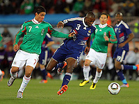 Pablo Barrera of Mexico (L) and Eric Abidal of France