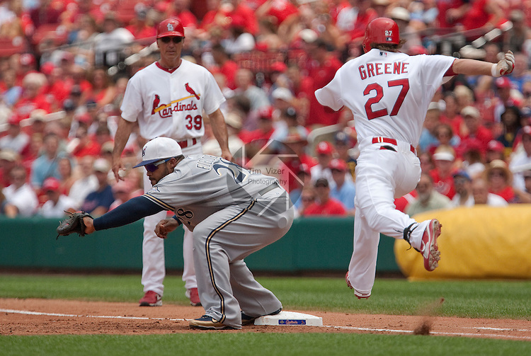 July 4, 2010          Milwaukee Brewers first baseman Prince Fielder (28) reaches and makes the catch and the out on baserunner St. Louis Cardinals shortstop Tyler Greene (27) as Greene makes one last leap trying to beat the throw.  In background is Cardinals first base coach Dave McKay(39).  The St. Louis Cardinals defeated the Milwaukee Brewers 7-1 in the final game of a four-game homestand at Busch Stadium in downtown St. Louis, MO on Sunday July 4, 2010.