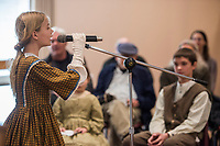 NWA Democrat-Gazette/ANTHONY REYES @NWATONYR<br /> Kyla Cross, 11, with the Shiloh Balladeers, sings Wednesday, March 15, 2017 one of several folk ballads at the Shiloh Museum of Ozark History in Springdale. Kyla joined other singers and performed songs like &quot;Skip to My Lou,&quot; &quot;Bangum and the Boar&quot; and &quot;The Dewy Dens of Yarrow&quot; which all link back to the Ozarks, though they may have long histories.