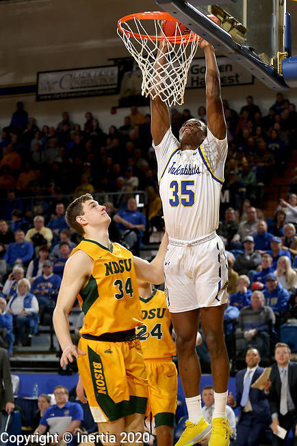 BROOKINGS, SD - JANUARY 22: Douglas Wilson #35 of the South Dakota State Jackrabbits slams home two points against the North Dakota State Bison at Frost Arena on January 22, 2020 in Brookings, South Dakota. (Photo by Dave Eggen/Inertia)