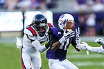 Samford Bulldogs wide receiver Malik Johns (11) and TCU Horned Frogs safety George Baltimore (7) in action during the game between the Samford Bulldogs and the TCU Horned Frogs at the Amon G. Carter Stadium in Fort Worth, Texas.  TCU leads Stamford 24 to 7 at halftime.