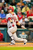 Matt Reynolds #5 of the Arkansas Razorbacks follows through on his swing against the Houston Cougars at Minute Maid Park on March 3, 2012 in Houston, Texas.  The Cougars defeated the Razorbacks 4-1.  (Brian Westerholt/Four Seam Images)
