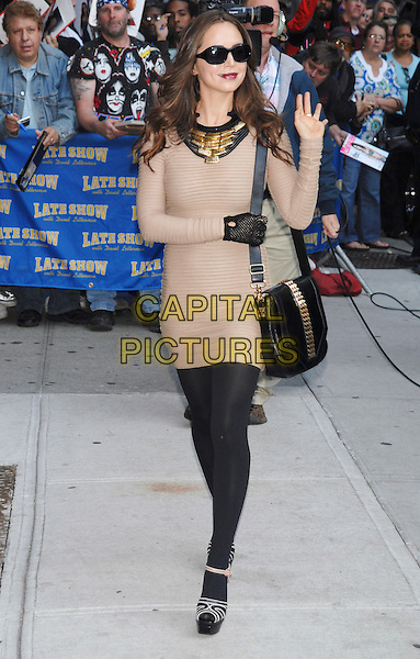 ELIZA DUSHKU.Appearance on the 'Late Show with David Letterman'.at the Ed Sullivan Theater, New York, NY, USA, .October 6th 2009.full length sunglasses beige sweater knitted jumper dress glove gold studded bag studs tights shoes platform sandals ankle strap peep toe bib necklace  collar hand waving  .CAP/LNC/TOM.©/LNC/Capital Pictures.