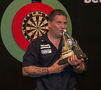 21.05.2015. London, England. Betway Premier League Darts Play-Offs.   Gary Anderson [SCO] wins the Betway Premier League final at The O2 in London beating Michael van Gerwen [NED] in the final.