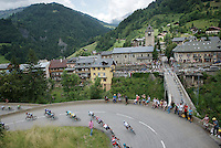 peloton entering the village of Flumet<br /> <br /> Stage 20: Meg&egrave;ve &rsaquo; Morzine (146.5km)<br /> 103rd Tour de France 2016
