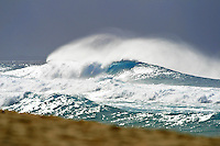 large sets of waves breaking under stormy tropical sky