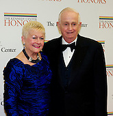 J.W. Marriott, Jr., Chairman and Chief Executive Officer of Marriott International, Inc., and his wife, Donna, arrive for the formal Artist's Dinner honoring the recipients of the 2012 Kennedy Center Honors hosted by United States Secretary of State Hillary Rodham Clinton at the U.S. Department of State in Washington, D.C. on Saturday, December 1, 2012. The 2012 honorees are Buddy Guy, actor Dustin Hoffman, late-night host David Letterman, dancer Natalia Makarova, and the British rock band Led Zeppelin (Robert Plant, Jimmy Page, and John Paul Jones)..Credit: Ron Sachs / CNP