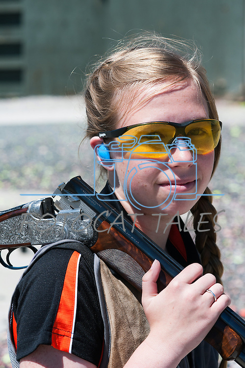 Alyssa Dunlap, 16 of Sonora Calif., poses with a $28,000 Beretta Gardone VT shotgun during the California Youth Shotgun Shooting Association&rsquo;s championship shootout at the Capitol City Gun Club in Carson City, Nev. on Saturday, May 2, 2015.<br /> Photo by Kevin Clifford/Nevada Photo Source