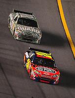 Jul. 5, 2008; Daytona Beach, FL, USA; NASCAR Sprint Cup Series driver Jeff Gordon (24) leads teammate Dale Earnhardt Jr (88) during the Coke Zero 400 at Daytona International Speedway. Mandatory Credit: Mark J. Rebilas-