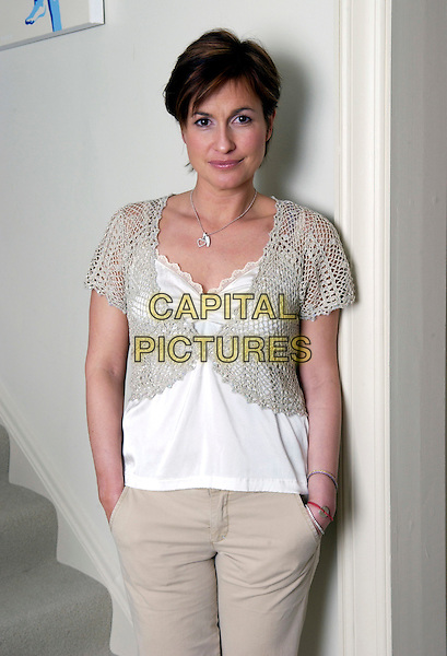 EMMA FORBES.Photographed at her London home,.11th February 2005..half length beige cream shrug cropped crochet cardigan camisole vest top trousers silver diamante heart charm necklace bracelets hands in pockets.Ref: DH.www.capitalpictures.com.sales@capitalpictures.com.©Capital Pictures.