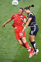 LA Sol's Brittney Bock and Washington Freedom's Abby Wambach battle. The LA Sol defeated the Washington Freedom 2-0 in the opening game of Womens Professional Soccer at Home Depot Center stadium on Sunday March 29, 2009.  .Photo by Michael Janosz