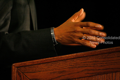 Chicago, IL - December 3, 2008 -- United States President-elect Barack Obama wears a bracelet engraved with the name of Sergeant Ryan David Jopek as he addresses reporters at news conference announcing New Mexico Governor Bill Richardson as his secretary of commerce in Chicago on December 3, 2008. Jopek was killed in Iraq by a roadside bomb on August 2, 2006, and the bracelet was given to Obama by Jopek's mother while he was on the campaign trail. .Credit: Brian Kersey - Pool via CNP