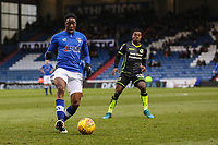 Oldham Athletic's Queensy Menig (left) is watched by Bristol Rovers' Marc Bola (right) during the Sky Bet League 1 match between Oldham Athletic and Bristol Rovers at Boundary Park, Oldham, England on 30 December 2017. Photo by Juel Miah / PRiME Media Images.