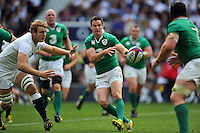 Jonathan Sexton of Ireland passes the ball. QBE International match between England and Ireland on September 5, 2015 at Twickenham Stadium in London, England. Photo by: Patrick Khachfe / Onside Images