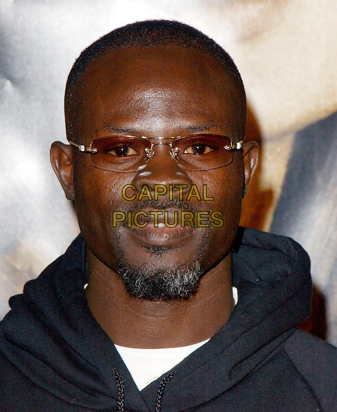 DJIMON HOUNSOU.World Premiere of Taking Lives held at The Grauman's Chinese Theatre in Hollywood, California .16 March 2004.*UK Sales Only*.glasses, headshot, portrait, beard, goatee, stubble.www.capitalpictures.com.sales@capitalpictures.com.©Capital Pictures.
