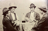 BNPS.co.uk (01202 558833)<br /> Pic: SofeDesignAuctions/BNPS<br /> <br /> $1million tin type...<br /> <br /> Hands Up...if you want to buy this almost unique photograph of notorious gunman Billy the Kid.<br /> <br /> A remarkable photograph showing wild west gunman Billy the Kid (2nd left) playing cards with his gang has emerged for sale for almost £800,000.<br /> <br /> The black and white wet collodion tin type image is thought to dates back to around 1877 and is only the second confirmed image of the notorious American outlaw to be known of.<br /> <br /> It shows him wearing a top hat sat around a table with three members of his gang - L-r Richard Brewer, Fred Waite and Henry Brown - all of whom were wanted men.