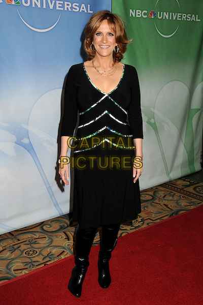 CAROL LEIFER .NBC Universal Press Tour Cocktail Party held at the Langham Hotel, Pasadena, California, USA, 10th January 2010..full length black dress boots .CAP/ADM/BP.©Byron Purvis/AdMedia/Capital Pictures.