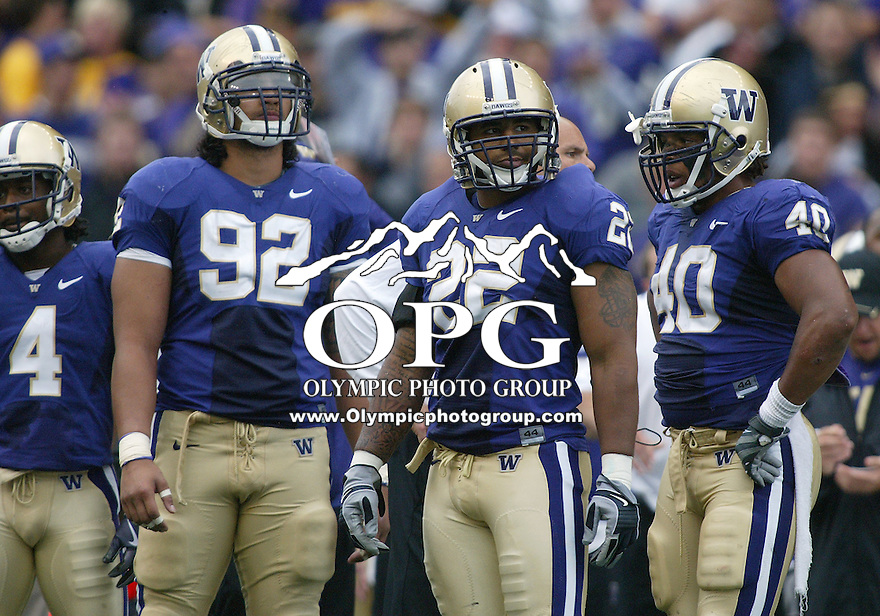 Sep 19, 2009:  Washington defensive players #92 Everrette Thompson (left) #22 E.J. Savannah (center) and #40 Mason Foster (right) set up on defense against USC.  Washington defeated the USC 16-13 at Husky Stadium in Seattle, Washington..