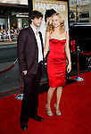 """HOLLYWOOD, CA. - June 02: Actress Heather Graham and guest arrive at the Los Angeles premiere of """"The Hangover"""" at Grauman's Chinese Theatre on June 2, 2009 in Hollywood, California."""