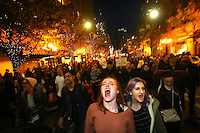 SEATTLE, WA - NOVEMBER 09: Sasha Savenko (center) and Sydney Kane (center right), both students at the University of Washington, join thousands of protesters march down 2nd Avenue on November 9, 2016 in Seattle. The rally was held in reaction to Donald Trump winning last night's US Presidential election. (Photo by Karen Ducey/Getty Images)