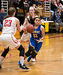 WINSTED,  CT-021919JS12-  Gilbert's Marcela Moreira (12) drives to the basket between Northwestern's Jana Sanden (23) and Skylar Dimartino (11) during their Berkshire League semi-final game Tuesday at Northwestern Regional High School in Winsted. <br /> Jim Shannon Republican American