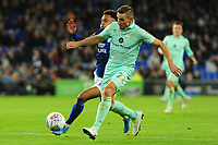 Josh Murphy of Cardiff City vies for possession with Àngel Rangel of Queens Park Rangers during the Sky Bet Championship match between Cardiff City and Queens Park Rangers at the Cardiff City Stadium in Cardiff, Wales, UK. Wednesday 02 October, 2019