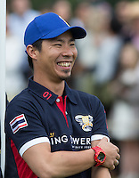 Smiles from Apichet Srivaddhanaprabha (King Power) during the Cartier Queens Cup Final match between King Power Foxes and Dubai Polo Team at the Guards Polo Club, Smith's Lawn, Windsor, England on 14 June 2015. Photo by Andy Rowland.