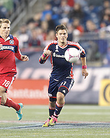 New England Revolution midfielder Kelyn Rowe (11) brings the ball forward. In a Major League Soccer (MLS) match, the New England Revolution (blue) defeated Chicago Fire (red), 1-0, at Gillette Stadium on October 20, 2012.