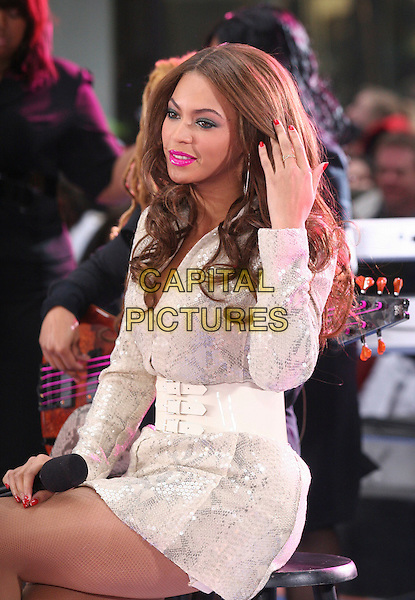 BEYONCE KNOWLES.Beyonce performs on the NBC Today Show at Rockafella Plaza, New York, NY, USA, 02 April 2007..half length white mini coat dress belt live on stage concert gig pink lipstick fishnet tights hand touching hair.CAP/IW.©Ian Wilson/Capital Pictures