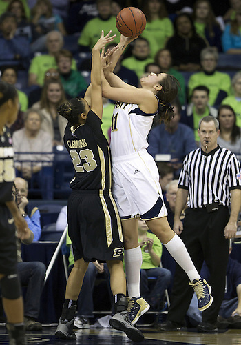 December 29, 2012:  Notre Dame forward Natalie Achonwa (11) goes up for a shot as Purdue forward Liza Clemons (23) defends during NCAA Women's Basketball game action between the Notre Dame Fighting Irish and the Purdue Boilermakers at Purcell Pavilion at the Joyce Center in South Bend, Indiana.  Notre Dame defeated Purdue 74-47.