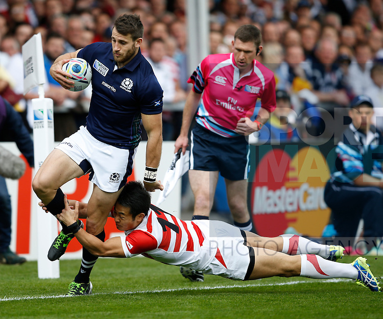 Tommy Seymour of Scotland tackled into touch by Kenki Fukuoka of Japan - Rugby World Cup 2015 - Pool B - Scotland vs Japan - Kingsholm Stadium - Gloucester - England - 23rd September 2015 - Picture Simon Bellis/Sportimage