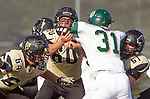 Palos Verdes, CA 10/25/13 - Carlo Merola (Peninsula #60) and Jahlani Tavai (Mira Costa #31) and Johnny Kimura (Peninsula #64) in action during the Mira Costa vs Peninsula varsity football game at Palos Verdes Peninsula High School.